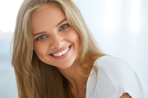 blond girl smiling white teeth cosmetic dentistry
